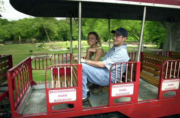 In this file photo a couple ride the quaint and intimate Brackenridge Park Eagle. A local spot for puppy love and old-fashioned courting. Photo: BOB OWEN, EN / EN