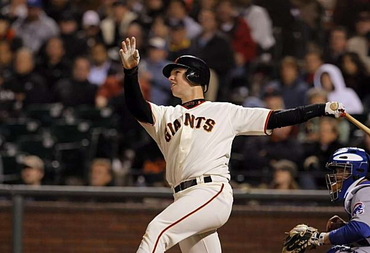 Buster Posey watches his two-run double in the seventh inning Tuesday at AT&T Park.