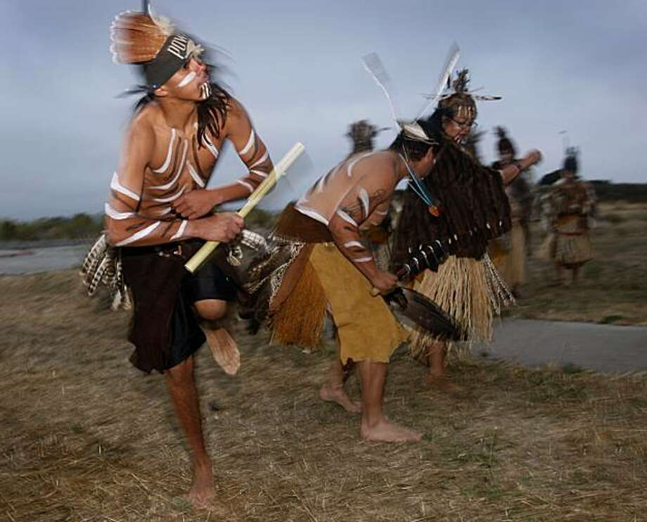 Marcus Rodriguez (left) performs with other Ohlone dancers during a sunrise ceremony at Yosemite Slough in San Francisco, Calif., on Tuesday, Aug. 10, 2010. Tribal representatives will appear before the Board of Supervisors to urge inclusion in the committee overseeing the redevelopment of the Hunters Point Shipyard. Photo: Paul Chinn, The Chronicle