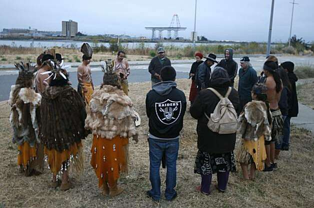 Ohlone tribe members participate in a sunrise ceremony at Yosemite Slough in San Francisco, Calif., on Tuesday, Aug. 10, 2010. Tribal representatives will appear before the Board of Supervisors to urge inclusion in the committee overseeing the redevelopment of the Hunters Point Shipyard. Photo: Paul Chinn, The Chronicle