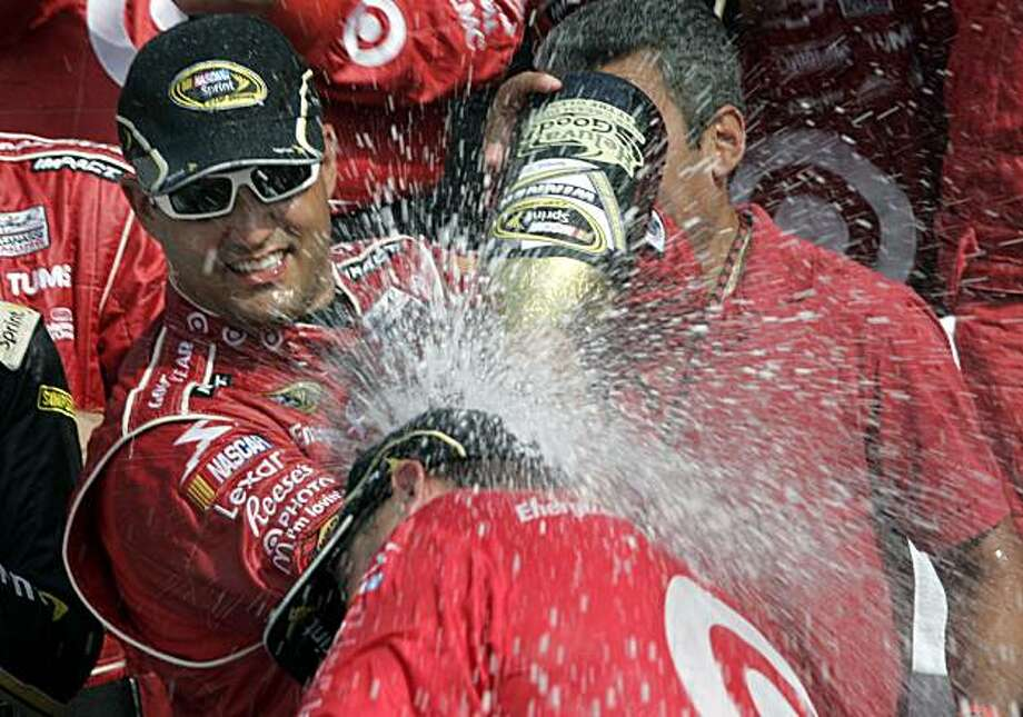 Juan Pablo Montoya celebrates winning the NASCAR Sprint Cup Series' Heluva Good! Sour Cream Dips at The Glen auto race in Watkins Glen, N.Y., Sunday, Aug. 8, 2010. Photo: Charles Berch, AP