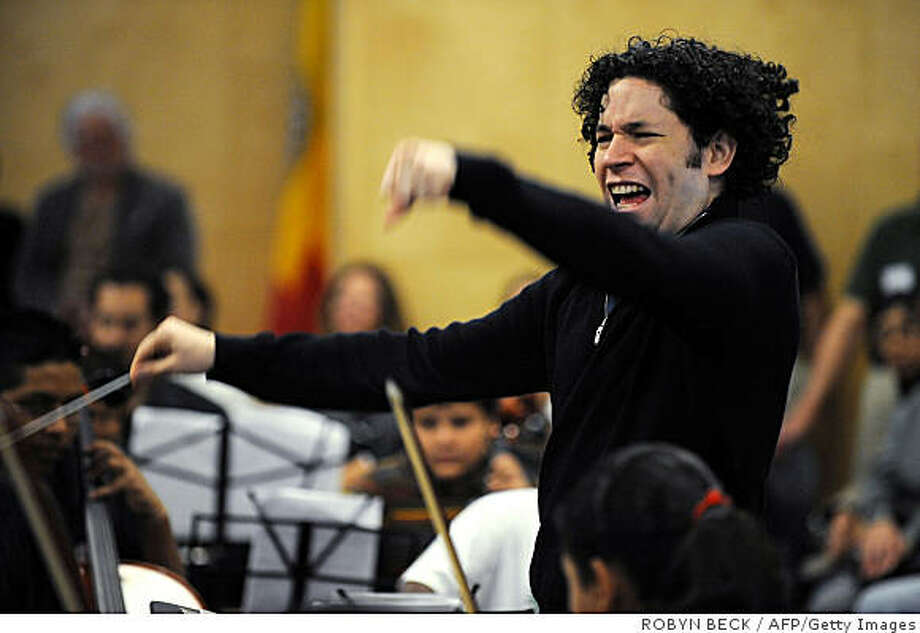 Conductor Gustavo Dudamel leads a rehearsal of the EXPO Center Youth Orchestra, on December 6, 2008 at the EXPO center in downtown Los Angeles, California. The 27-year-old Venezuelan, who will become the music director of the Los Angeles Philharmonic next year, led the youth orchestra in a rehearsal. AFP PHOTO / ROBYN BECK    = MORE PHOTOS IN IMAGE FORUM = (Photo credit should read ROBYN BECK/AFP/Getty Images) Photo: ROBYN BECK, AFP/Getty Images