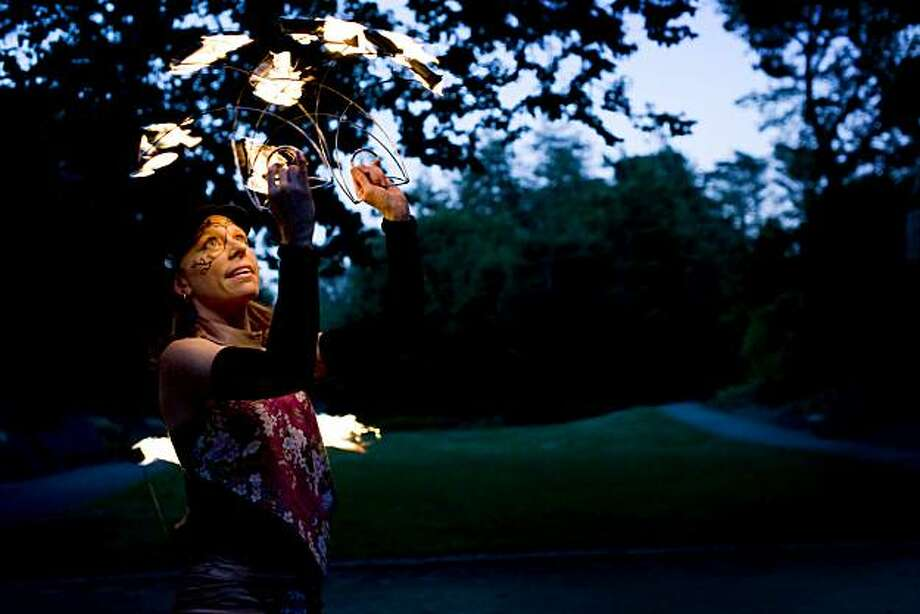 Fire dancer Brenda Fagan practices her art in the National Aids Memorial Grove in Golden Gate Park of San Francisco, Calif., on Tuesday, June 29, 2010. Photo: Chad Ziemendorf, The Chronicle