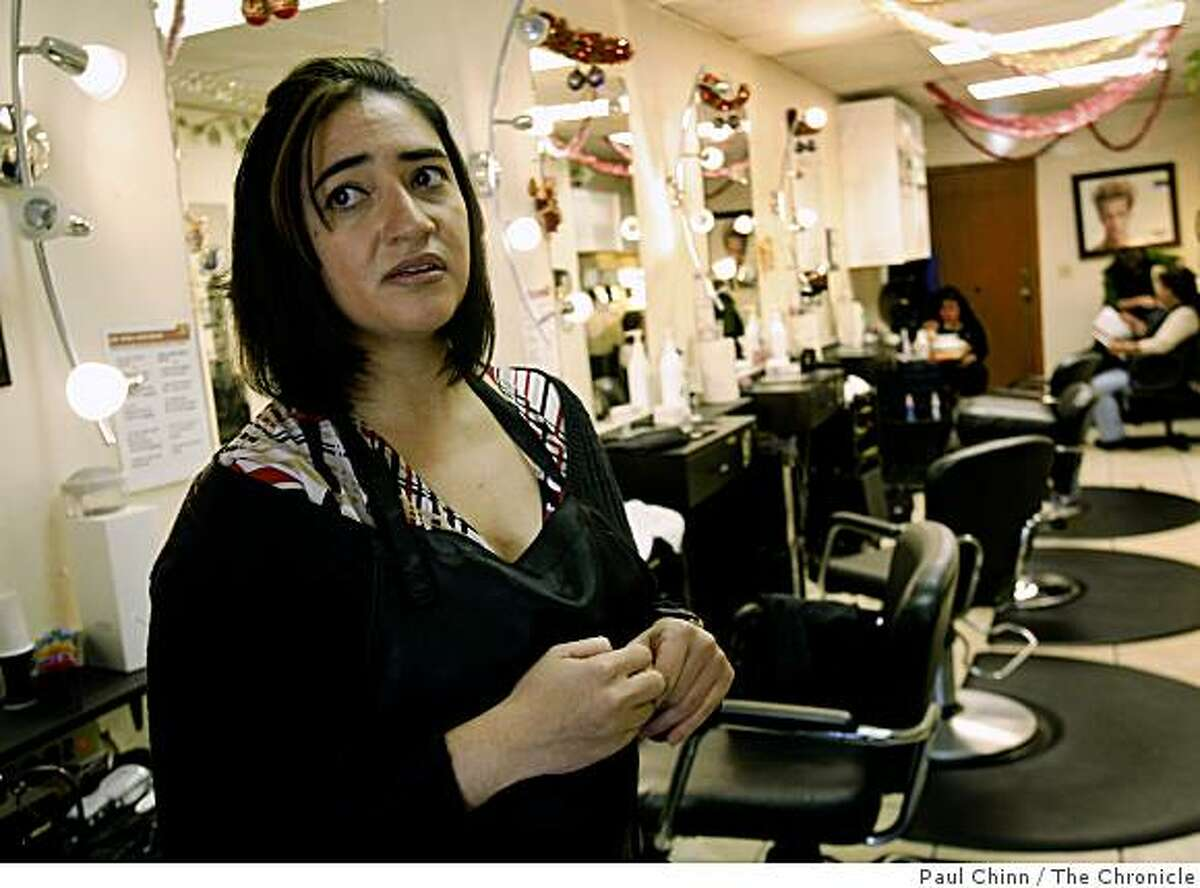 Gloria Salazar, who works as a hair stylist at a Fruitvale district salon in Oakland, Calif., said on Wednesday, Dec. 17, 2008 that the business closes before dark because of the high crime rate in the neighborhood.