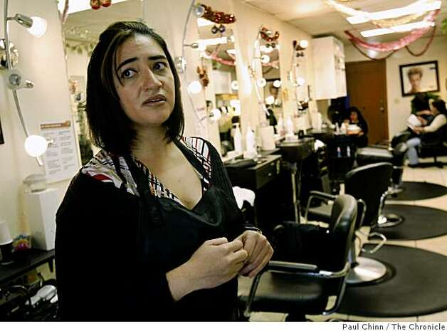 Gloria Salazar, who works as a hair stylist at a Fruitvale district salon in Oakland, Calif., said on Wednesday, Dec. 17, 2008 that the business closes before dark because of the high crime rate in the neighborhood. Photo: Paul Chinn, The Chronicle