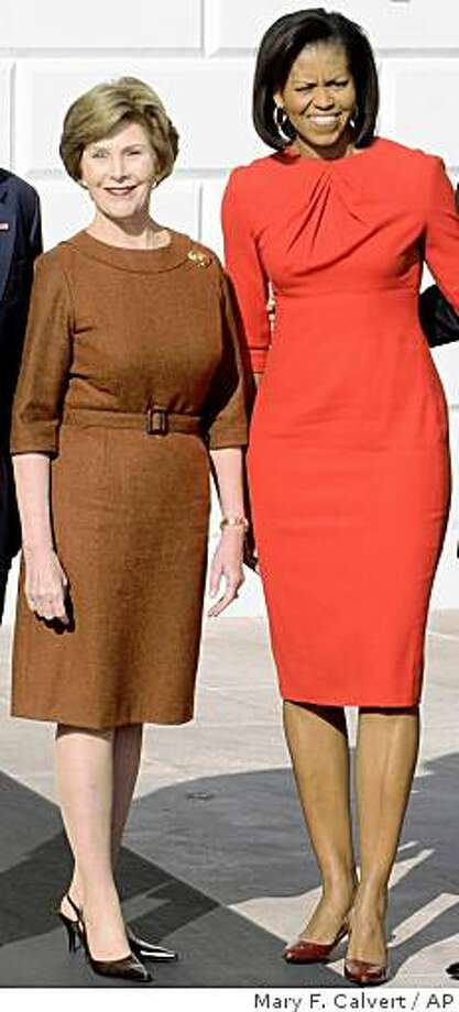 Michelle Obama' s fashion choices were the talk of the latter half of 2008. .  ** FOR USE AS DESIRED WITH YEAR END--FILE **In this Nov. 10, 2008 file photo, President Bush and first lady Laura Bush, welcome President-elect Obama and his wife Michelle Obama to the White House in Washington.  (AP Photo/The Washington Times, Mary F. Calvert/FILE) Photo: Mary F. Calvert, AP