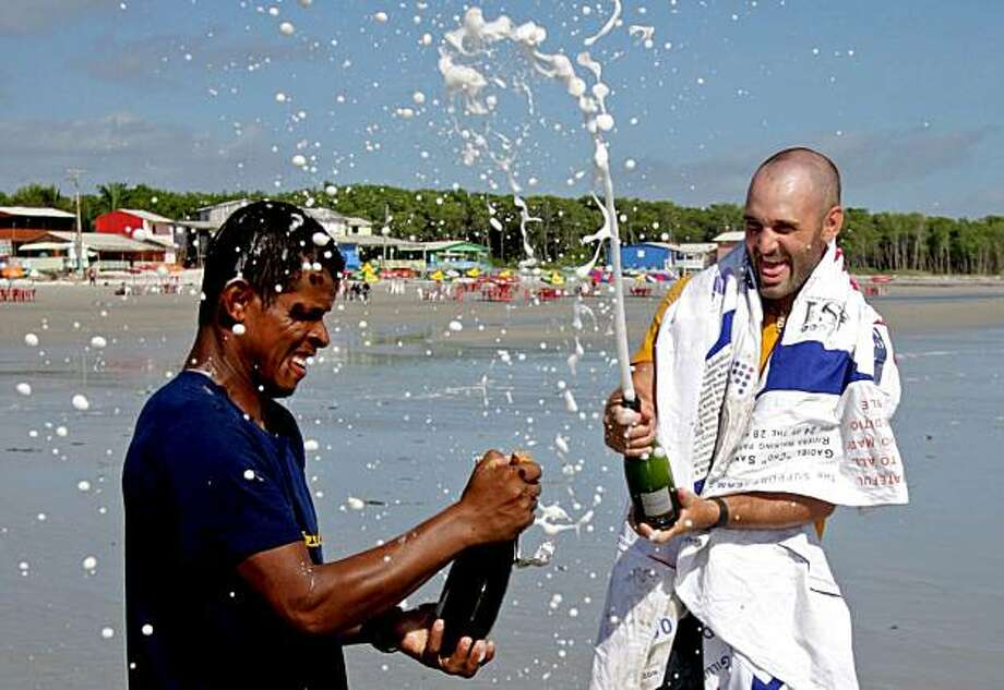 "Ed Stafford, of England, right, and Gadiel ""Cho"" Sanchez Rivera, of Peru, celebrate arriving to Crispim beach in Marapanim in Brazil's Para state, Monday Aug. 9, 2010. After 859 days and thousands of miles Ed Stafford became the first man known to have walked the entire length of the Amazon river. Photo: Renato Chalu, AP"