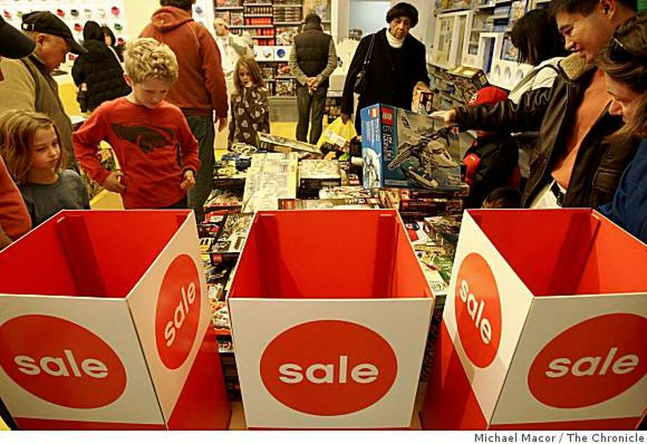 """Shoppers search the sale table at the """"Lego"""" toy store inside the Hillsdale Shopping Center in San Mateo, Calif., for after Christmas day bargains, on Friday Dec. 26, 2008. Photo: Michael Macor, The Chronicle"""