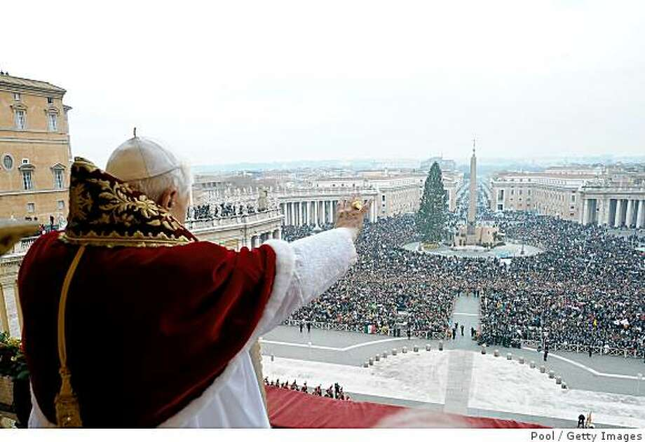VATICAN CITY - DECEMBER 25:  Pope Benedict XVI delivers his Christmas Urbi Et Orbi blessing from the central balcony of St Peter's Basilica on December 25, 2008 in the Vatican City.  (Photo by L'Osservatore Romano - Vatican Pool via Getty Images) Photo: Pool, Getty Images