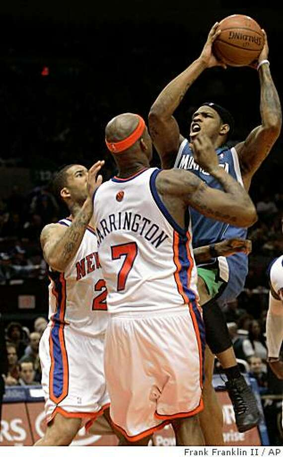 Minnesota Timberwolves' Rashad McCants, right, shoots over New York Knicks' Al Harrington (7), New York Knicks' Wilson Chandler, left, during the first half of an NBA basketball game Friday, Dec. 26, 2008  in New York. McCants scored 23 points as the Timberwolves won the game 120-107. (AP Photo/Frank Franklin II) Photo: Frank Franklin II, AP