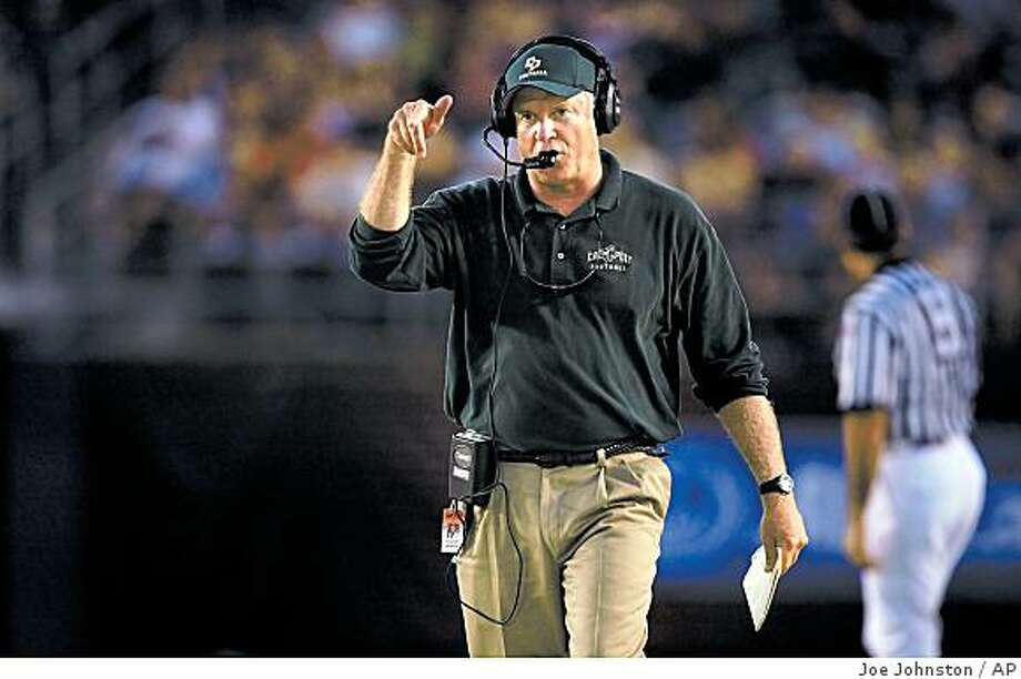 ** FILE ** In this Aug. 30, 2008 file photo, Cal Poly coach Rich Ellerson gestures during an NCAA college football game against San Diego State in San Diego. Ellerson was hired as Army's football coach on Friday, Dec. 26, 2008, joining a team that hasn't had a winning record since 1996. (AP Photo/The Tribune (of San Luis Obispo), Joe Johnston) Photo: Joe Johnston, AP
