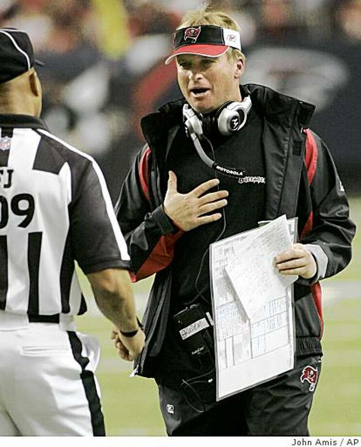 Tampa Bay Buccaneers head coach Jon Gruden, right, has words with line judge Dyrol Prioleau during the first half of an NFL football game against the Atlanta Falcons, Sunday, Dec. 14, 2008, in Atlanta. Atlanta won 13-10. (AP Photo/John Amis) Photo: John Amis, AP