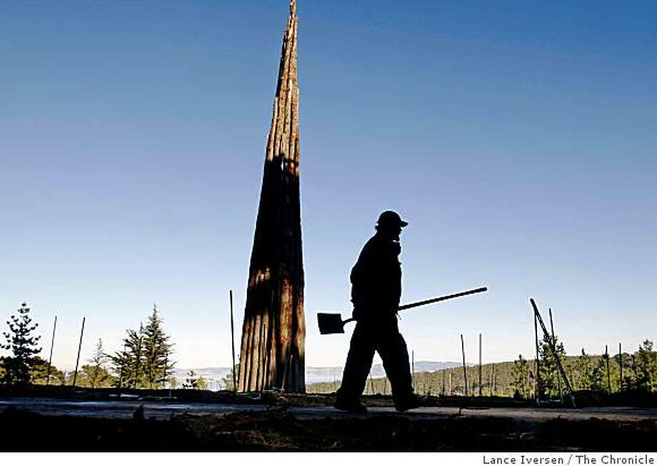 Presidio Trust employee Terry Langan from San Francisco works on the restoration of the Bay Ridge trail in front of the spire, an environmental piece of artwork by Andy Goldsworthy Wednesday Dec 17, 2008. Photo: Lance Iversen, The Chronicle