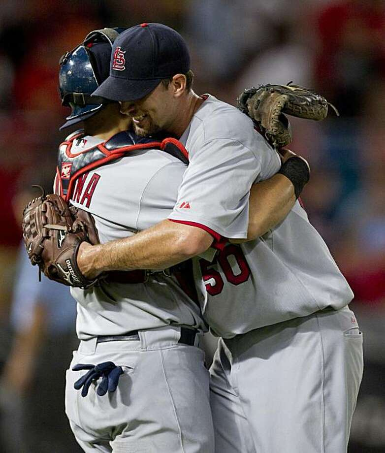 St. Louis Cardinals catcher Yadier Molina, left, and starting pitcher Adam Wainwright celebrate after they defeated the Florida Marlins 7-0 in a baseball game on Friday, Aug. 6, 2010, in Miami. Wainwright went the entire game giving up no runs on two hits. Photo: J Pat Carter, AP
