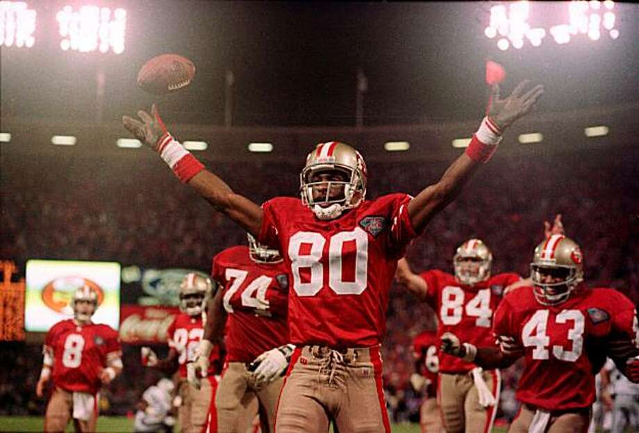 JERRY RICE/C/07SEP94/SP/DF - 49ER JERRY RICE  CELEBRATES HIS RECORD SETTING TOUCHDOWN AGAINST THE RAIDERS SPECIAL SECTION: SUPER SEASON  Photo by Deanne Fitzmaurice  Ran on: 02-26-2005 Jerry Rice holds numerous NFL records, including total TDs, a mark he broke against the Raiders on a Monday night.  Ran on: 02-26-2005 Jerry Rice holds numerous NFL records, including total TDs, a mark he broke against the Raiders on a Monday night. Photo: Deanne Fitzmaurice, The Chronicle