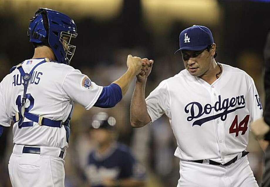 Los Angeles Dodgers starting pitcher Vicente Padilla, right, and catcher Brad Ausmus celebrate after their team defeated the San Diego Padres in a baseball game in Los Angeles, Wednesday, Aug. 4, 2010. The Dodgers won 9-0. Photo: Jae C. Hong, AP