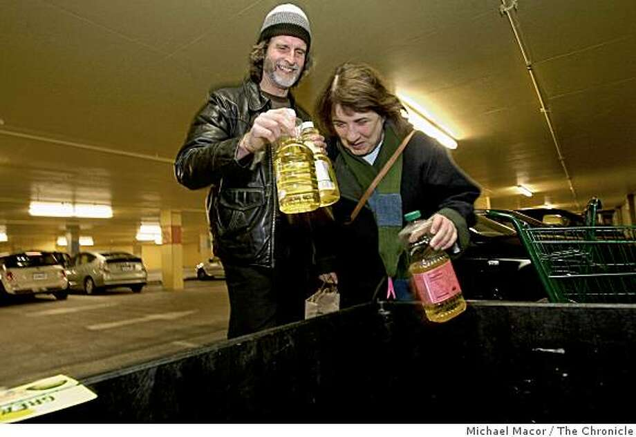 "Ray and Lorrain Lucas of San Francisco drop off their plastic bottles filled with cooking oil at the Whole Foods Market at the corner of Rhode Island and 16th Streets, on Dec. 27, 2008, as part of San Francisco's ""SF Greasecycle"" program, turning cooking oils into biofuels. Photo: Michael Macor, The Chronicle"