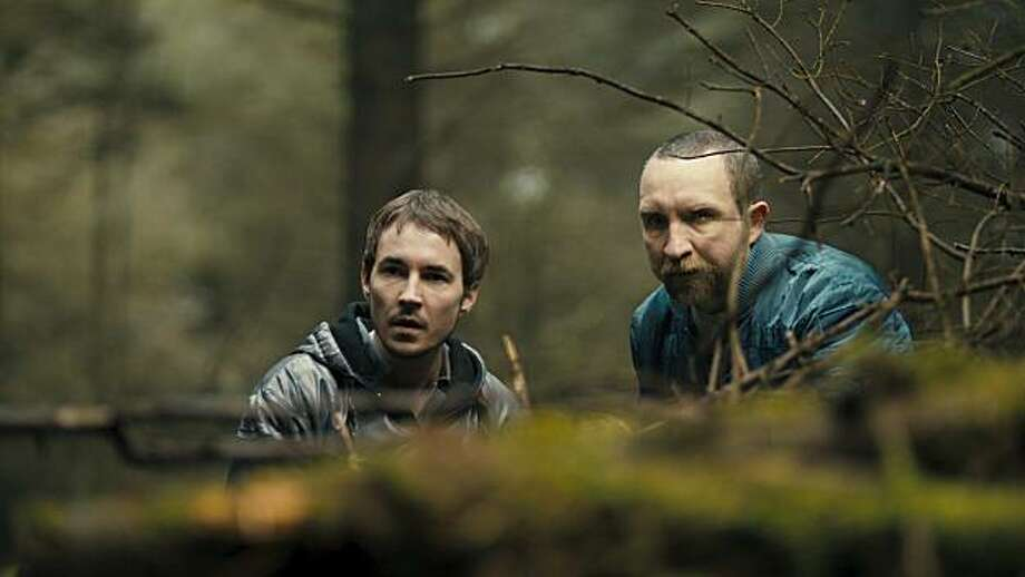 "In this publicity photo provided by Anchor Bay Films, actor Martin Compston, left, plays the role of Danny and actor Eddie Marsan plays the role of Vic in the film, ""The Disappearance of Alice Creed"". Photo: David Oxberry, AP"