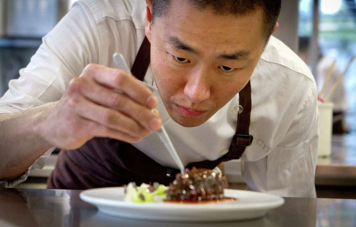 Chef Corey Lee prepares sea cucumber stuffed with shrimp at the four-star Benu.