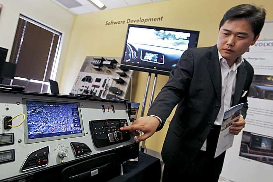 Chuhee Lee, head of infotainment at Volkswagen AG's (VW) Electronics Research Lab, points out a Google Earth view navigation system at the company's facility in Palo Alto, California, U.S., on Sunday, Aug. 1, 2010. Automakers are meeting with Silicon Valley developers in an attempt to boost sales by adding so-called infotainment technology, including features such as iPhone-style applications, social networking, and Internet radio, into their vehicles. The VW lab, which opened in 1998, is working on innovations such as autonomous driving, the idea of a car navigating itself. Photographer: Tony Avelar/Bloomberg *** Local Caption *** Chuhee Lee   HOLD FOR STORY BY RYAN FLINN Photo: Tony Avelar, Bloomberg
