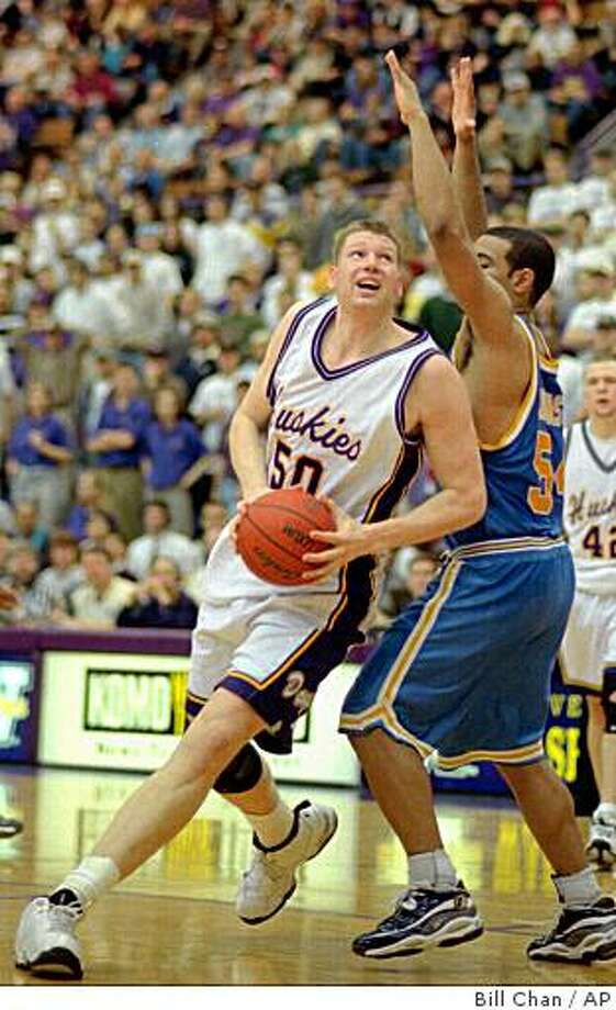 Washington's Todd MacCulloch drives twords the basket as UCLA's Kris Johnson defends during their Sunday March 1, 1998 game in Seattle. MacCulloch scord 25 point as Washington beat UCLA 95-94. (AP Photo/Bill Chan) Photo: Bill Chan, AP