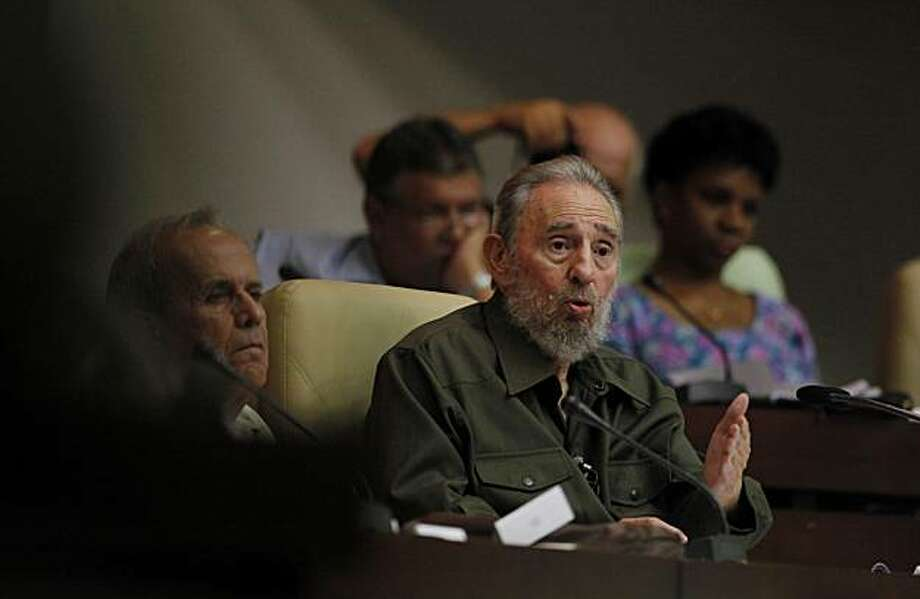 Fidel Castro speaks during a special session of parliament in his first official government appearance in front of lawmakers in four years in Havana, Cuba, Saturday Aug. 7, 2010. Castro, who turns 84 on Aug. 13, is making near daily appearances in and around Havana after spending four years almost completely out of the public eye following emergency intestinal surgery that forced him to cede power to his younger brother Raul. At left is Ricardo Alarcon, president of parliament. Photo: Javier Galeano, AP
