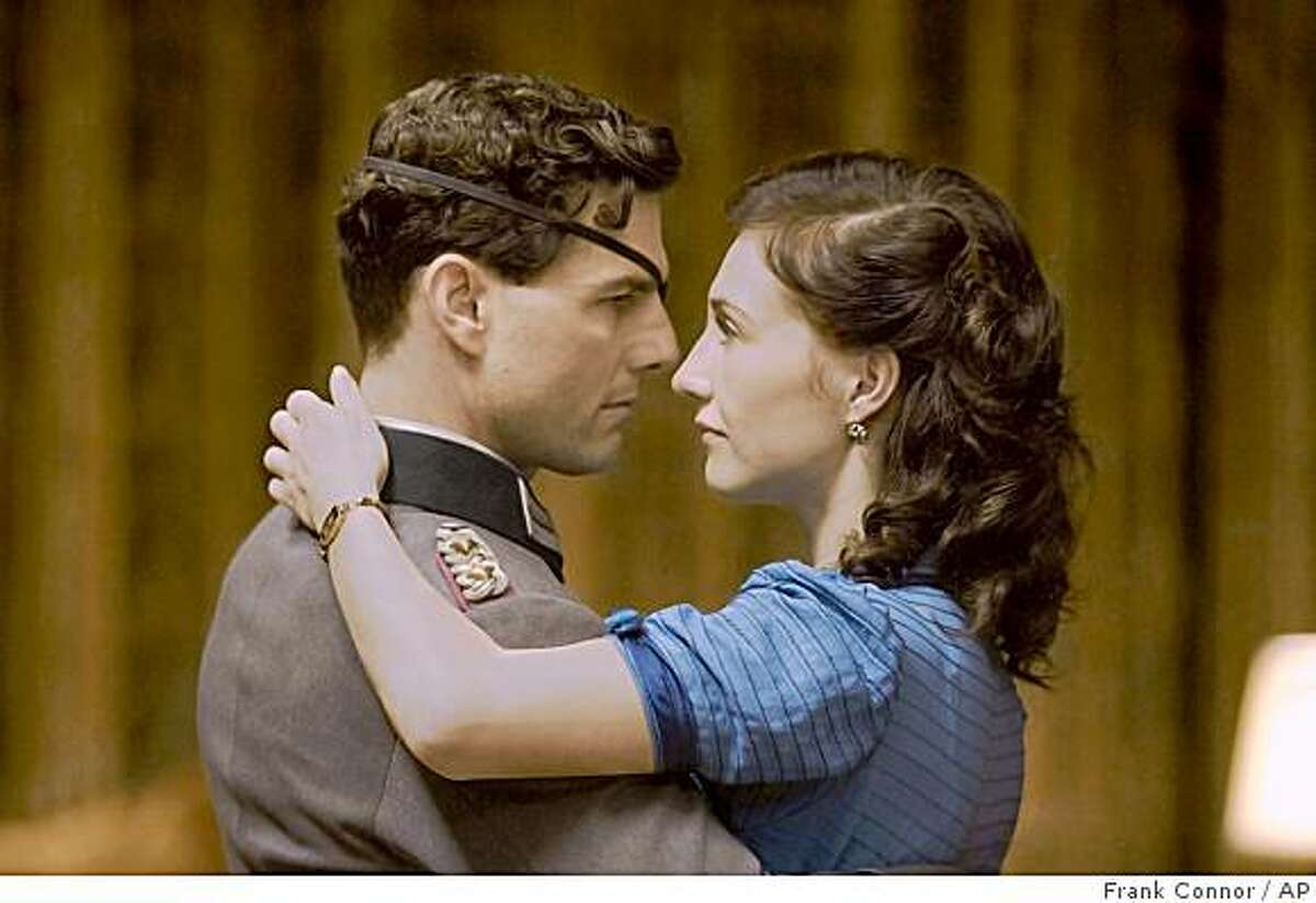 In this image released by MGM, Tom Cruise portrays Claus von Stauffenberg, left, and Carice Van Houten portrays his wife, Nina, in