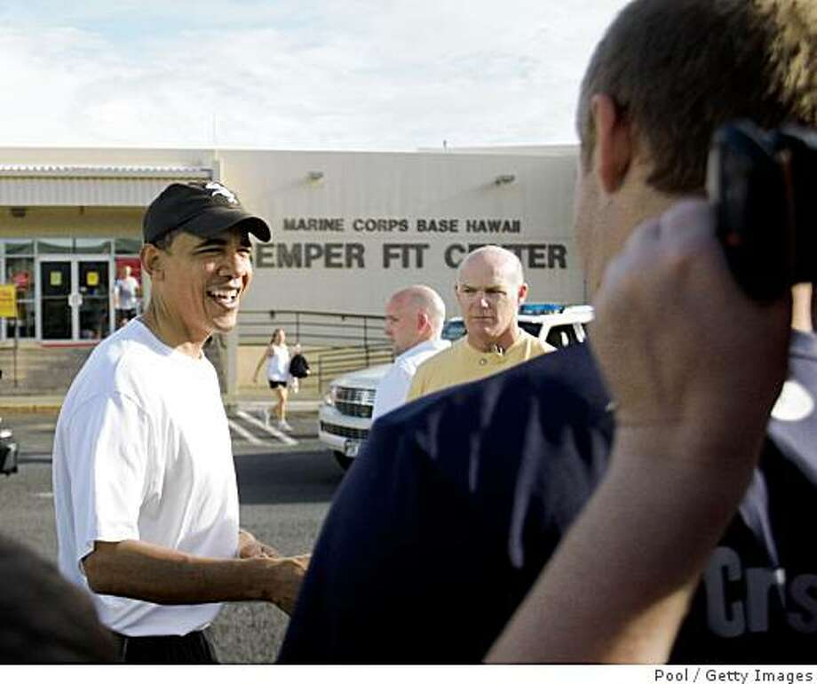 HONOLULU, HI - DECEMBER 26: (AFP OUT) U.S. President-elect Barack Obama greets well-wishers after his morning exercise at Marine Corps Base Hawaii Kaneohe Bay on December 26, 2008 in Honolulu, Hawaii. Mr. Obama and his family arrived in his native Hawaii December 20 for the Christmas holiday. (Photo by Kent Nishimura-Pool/Getty Images) Photo: Pool, Getty Images