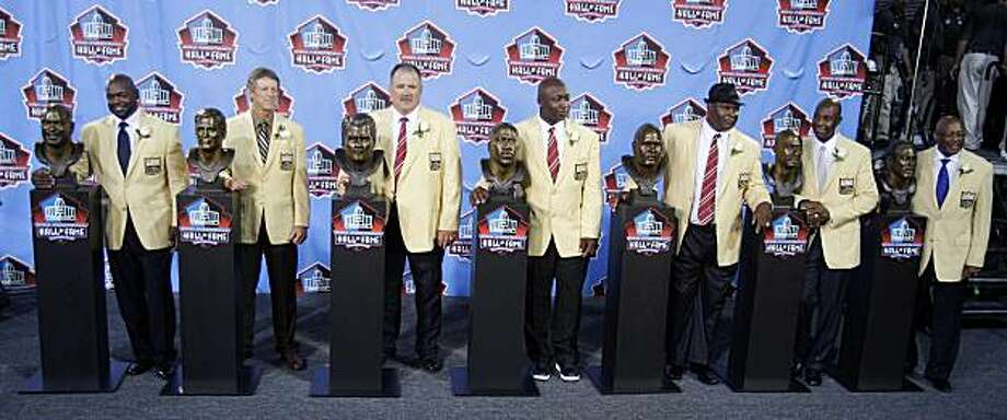 The 2010 Pro Fotball Hall of Fame class. From left: Emmitt Smith, Dick LeBeau, Russ Grimm, John Randle, Rickey Jackson, Jerry Rice and Floyd Little after enshrinement ceremonies at the Pro Football Hall of Fame in Canton, Ohio Saturday, Aug. 7, 2010. Photo: Mark Duncan, AP