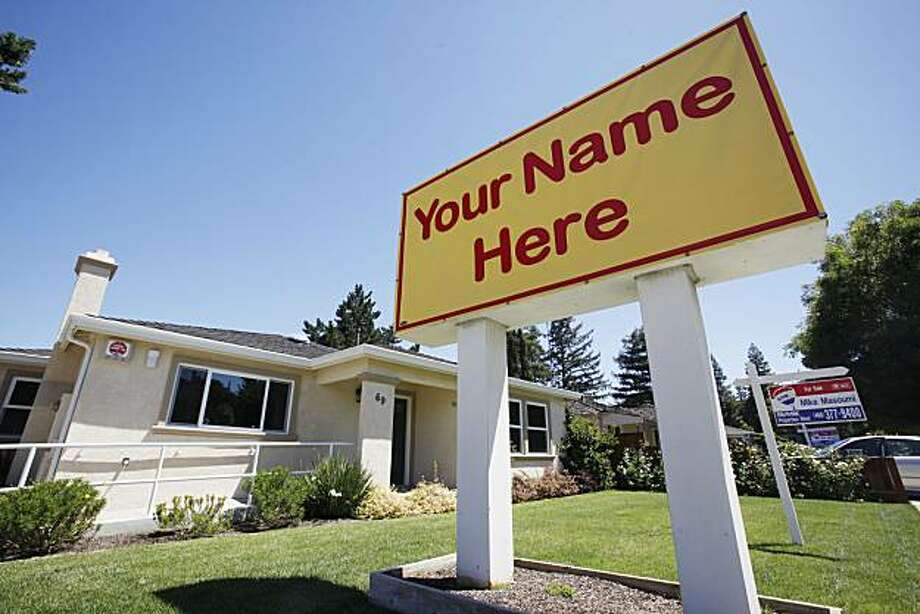 "In this July 22, 2010 photo, a home listed for sale, with a ""Your Name Here"" sign, is displayed in Campbell, Calif. Home prices rose in May for the second straight month as federal tax incentives pulled more buyers into the market. Photo: Paul Sakuma, AP"