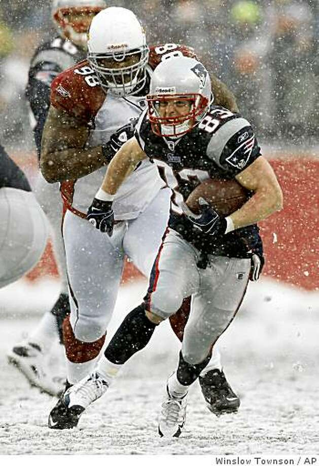 New England Patriots' Wes Welker is chased by Arizona Cardinals' Gabe Watson (98) during the second quarter of an NFL football game Sunday, Dec. 21, 2008, in Foxborough, Mass. (AP Photo/Winslow Townson) Photo: Winslow Townson, AP