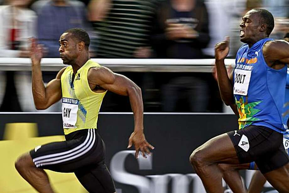 Tyson Gay of the U.S., left, wins the men's 100m race ahead of Jamaica's Usain Bolt at the IAAF Diamond League 'DN Galan' at the Stockholm Olympic Stadium in Stockholm, Sweden, Friday Aug. 6, 2010. Photo: Niklas Larsson / SCANPIX, AP