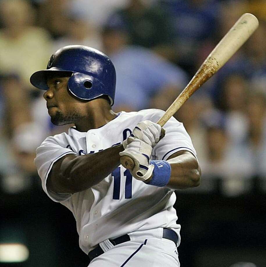 Kansas City Royals' Jose Guillen hits an RBI double during the eighth inning of a baseball game against the Chicago White Sox in Kansas City, Mo., Thursday, July 10, 2008. Guillen drove in teammate David DeJesus as the go-ahead run. The Royals beat the White Sox 4-1. (AP Photo/Orlin Wagner)  Use Information: