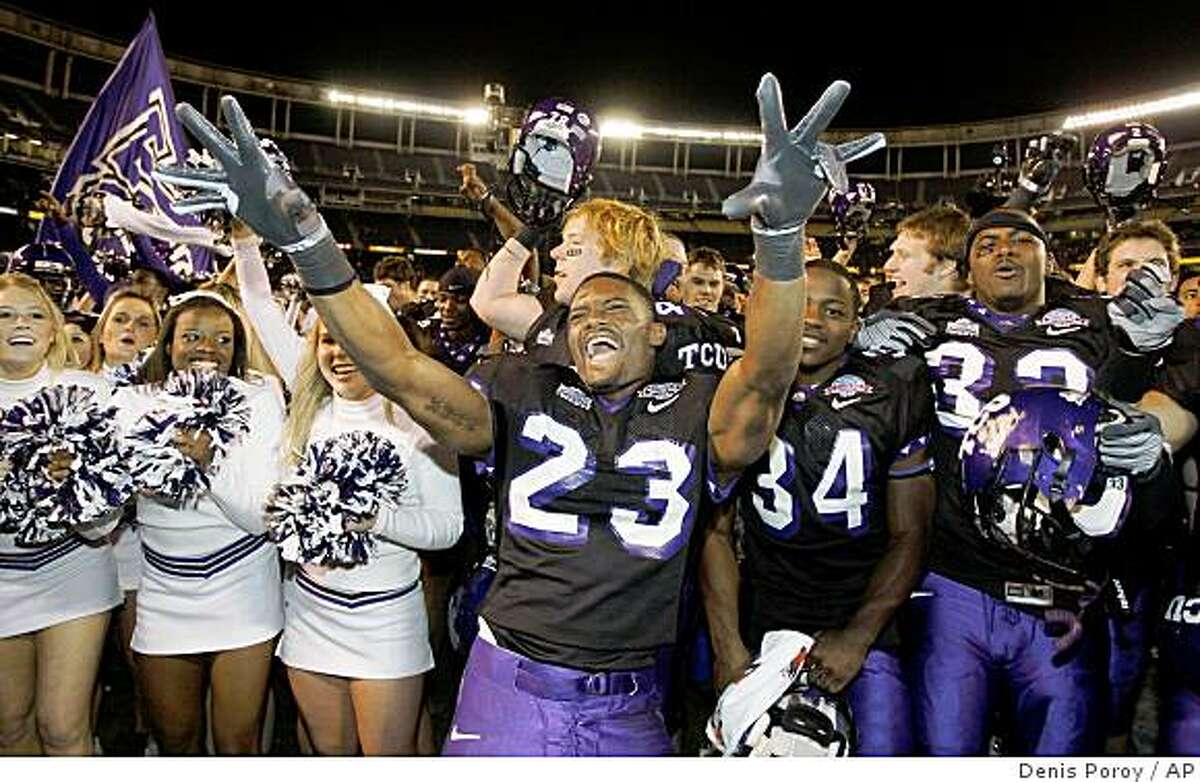 TCU tailback Aaron Brown (23) celebrates with the teammates and cheerleaders after TCU beat Boise State 17-16 in Poinsettia Bowl NCAA college football game Tuesday, Dec. 23, 2008, in San Diego. (AP Photo/Denis Poroy)