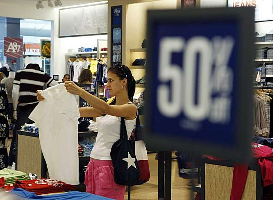 In this July 27, 2010 photo, fifty percent off signs are seen at an Aeropostale store, in Paramus, N.J. Worried about the stalling economic recovery, Americans remained reluctant to spend at stores in July, especially on pricier items like jewelry, thoughthey let go of some money for travel, according to data released Wednesday. Photo: Mel Evans, AP