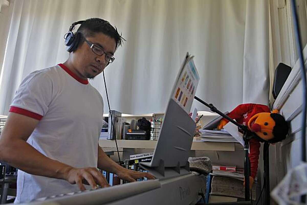 """Filmmaker H.P. Mendoza works on his musical scores at his home, Wednesday July 28, 2010, in San Francisco, Calif. His latest film 'Fruit Flies,"""" is a satirical musical which open the middle of August."""