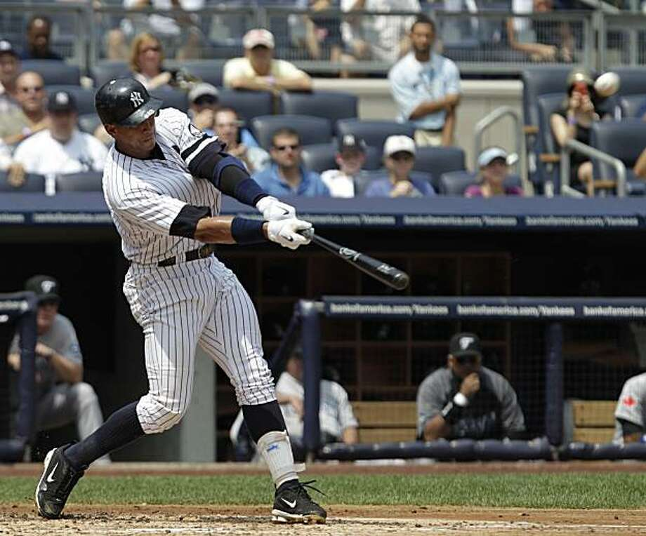 New York Yankees' Alex Rodriguez connects for his 600th career home run during the first inning of a baseball game against the Toronto Blue Jays at Yankee Stadium on Wednesday, Aug. 4, 2010 in New York. Photo: Kathy Willens, AP