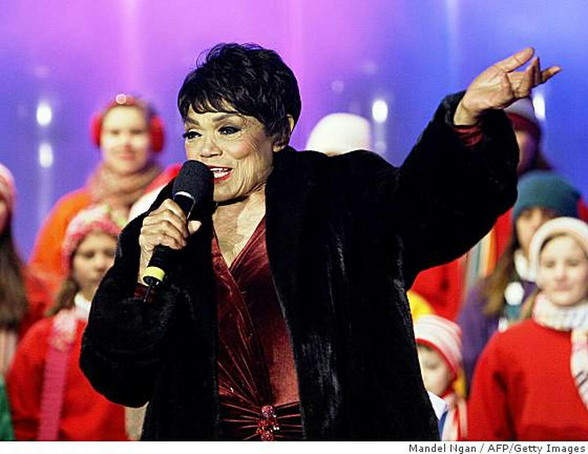 US singer Eartha Kitt performs 07 December 2006 at the Opening Ceremony of the 2006 Christmas Pageant of Peace at the Ellipse in Washington, DC. Kitt's publicist Patty Freedman told Cable News Network that Kitt died December 25, 2008 in New York. Kitt was 81. She was being treated for colon cancer, Freedman said.