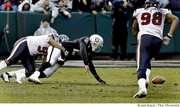 JaMarcus Russell fumbles in the fourth quarter but the Texans can't score on the opportunity. The Oakland Raiders vs the Houston Texans Sunday, December 21, 2008. Photo: Brant Ward, The Chronicle