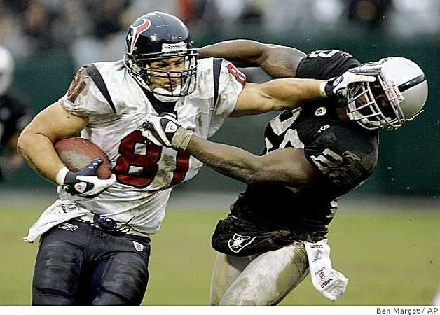 Houston Texans' Owen Daniels (81) straight-arms Oakland Raiders' Gibril Wilson, right, during the fourth quarter of a game Sunday, Dec. 21, 2008, in Oakland. Photo: Ben Margot, AP