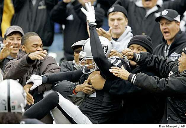 Oakland Raiders wide receiver Chad Schilens (81) leaps into the stands after scoring a touchdown against the Houston Texans during the first quarter of a game Sunday, Dec. 21, 2008, in Oakland. Photo: Ben Margot, AP