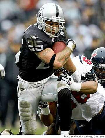 OAKLAND, CA - DECEMBER 21: Justin Fargas #25 of the Oakland Raiders runs against the Houston Texans during an NFL game on December 21, 2008 at the Oakland-Alameda County Coliseum in Oakland, California.  (Photo by Jed Jacobsohn/Getty Images) Photo: Jed Jacobsohn, Getty Images
