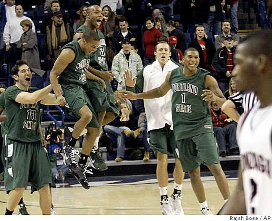 Portland State's Tyrell Mara (13), Dominic Waters (11), Andre Murray and Julius Thomas (1) celebrate their victory over Gonzaga after their NCAA college basketball game at the McCarthey Athletic Center in Spokane, Wash. Tuesday, Dec. 23, 2008. (AP Photo/Rajah Bose) Photo: Rajah Bose, AP