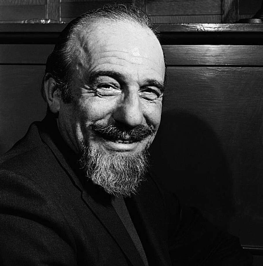 "FILE - In this file photo of Jan. 5, 1968, conductor Mitch Miller is seen at the Billy Rose Theater in New York. Miller, the goateed orchestra leader who asked Americans to ""Sing Along With Mitch"" on television and records, has died at age 99. His daughter said Miller died in New York City after a short illness. Photo: Bob Wands, AP"
