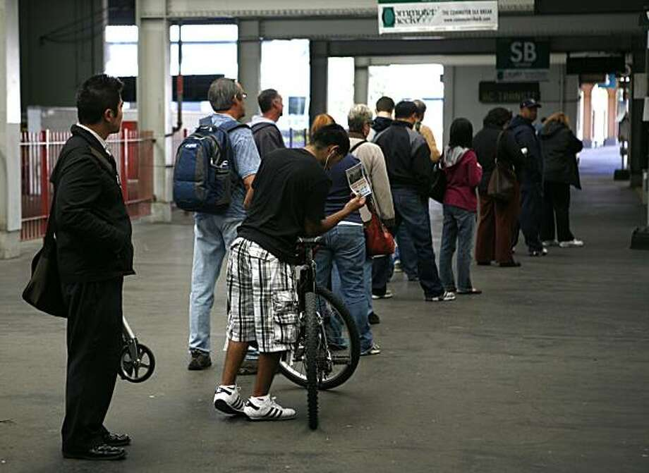 Commuters using the AC Transit bus line wait in long lines at the Transbay Terminal in San Francisco, Calif. on Friday Saturday 23, 2010. For the past week AC Transit riders have had to endure longer waits in lines as well as missed busses due to a dispute between the company and the union representing over a newly imposed contract. Photo: Jasna Hodzic, The Chronicle