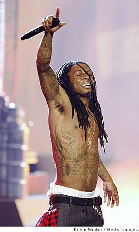 LOS ANGELES, CA - JUNE 24:  Rapper Lil' Wayne performs onstage during the 2008 BET Awards held at the Shrine Auditorium on June 24, 2008 in Los Angeles, California. Photo: Kevin Winter, Getty Images