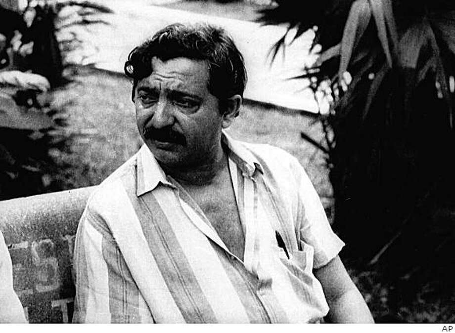 "** FILE ** In this Feb. 1988 file photo is seen Francisco ""Chico"" Mendes, an internationally acclaimed ecologist and advocate of the preservation of the Amazon Jungle in an unknown location in Brazil.  Mendes was shot and killed at his home in the remote Amazon jungle twenty years ago on Dec. 22, 1988. More than 1,100 activists, small farmers, judges, priests and other rural workers have been killed in disputes since Mendes' murder, according to the Catholic Land Pastoral, a watchdog group known as CPT. (AP Photo) Photo: AP"