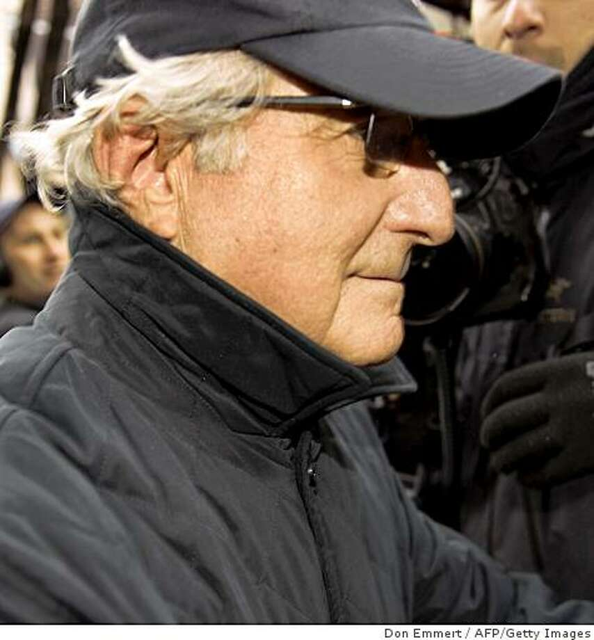 Bernard L Madoff walks down Lexington Ave to his apartment December 17, 2008 in New York City. US Wall Street baron Bernard Madoff was set tough new bail terms Wednesday including a curfew and wearing an electronic tag, as the US finance watchdog stepped up a probe into his alleged 50-billion dollar fraud. Madoff avoided what would have been his first court appearance since his arrest last Thursday by agreeing to stringent new restrictions under his 10-million dollar bail. AFP PHOTO/DON EMMERT (Photo credit should read DON EMMERT/AFP/Getty Images) Photo: Don Emmert, AFP/Getty Images