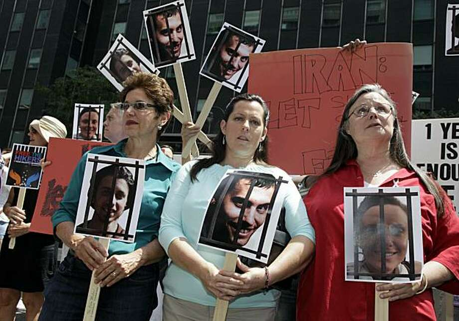 Laura Fattal, left, Cindy Hickey, center, and Nora Shourd, mothers of three American hikers jailed in Iran, participate in a demonstration outside Iran's mission to the United Nations, in New York,  Friday, July 30, 2010. Saturday marks a year since the hikers were arrested along the Iraqi border. Photo: Richard Drew, AP