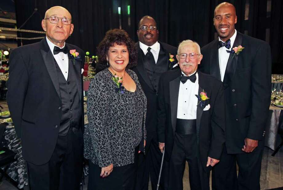 Stan Bonewitz (from left), Leticia Morales-Bissaro, David Hill, John Russell and Bruce Bowen were inducted Friday night. Photo: TOM REEL, San Antonio Express-News / San Antonio Express-News